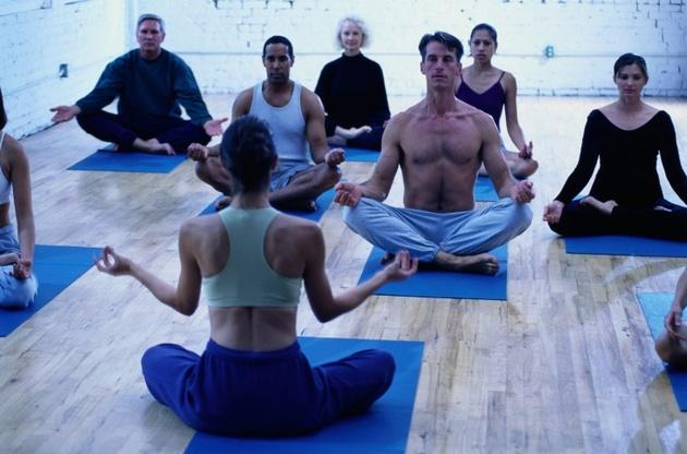 Yoga class with male athletes