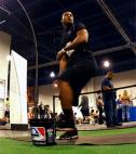 Former NFL player, D&#039;Juan Woods throws a pitch in the Men&#039;s Fitness Ultimate Athlete event during Olympia Weekend in Las Vegas, Nevada