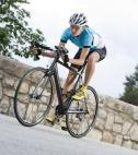 elite athlete - cyclist climbing a hill