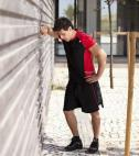 runner leaning against a wall - exhausted from extreme endurance exercise