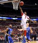 Louisville's Russ Smith dunking basketball