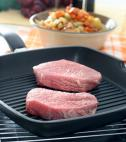 raw meat on grill pan