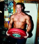John Cena holding barbell weight