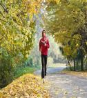 Man running in fall leaves