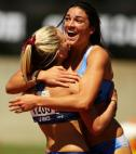 Track and field runner Michelle Jenneke hugs teammate.