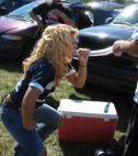 Woman uses funnel at college tailgating party