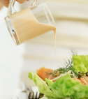 Pouring on Salad Dressing