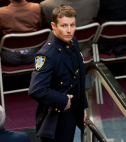Will Estes in cop uniform