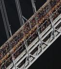 NYC marathon runners on bridge