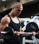 man doing barbell curl