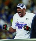 Michael Strahan yelling during football game