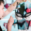 Man holding up lingerie