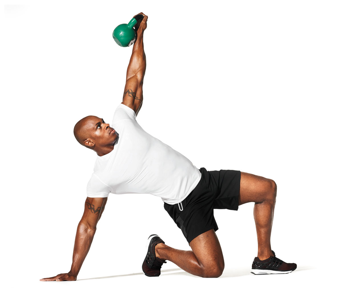 This photo shows a man doing kettle-bell work