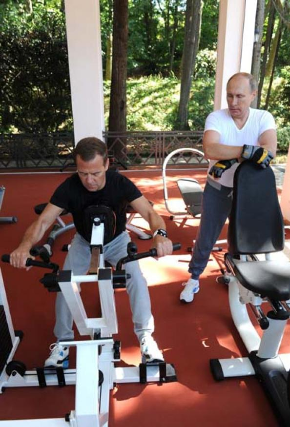 Vladimir Putin and Dmitry Medvedev work out in Sochi, Russia.