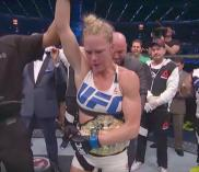Holly Holm receives the UFC bantamweight title belt after knocking out Ronda Rousey.