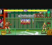 "Ronda Rousey's digital avatar faces off against Zangief in a ""Street Fighter II"" spoof."