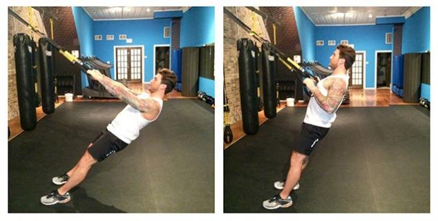 Adam Von Rothfelder of Drench Fitness Boutique demonstrates a 'row your boat' exercise on the TRX.
